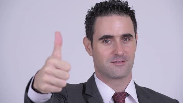 Thumbnail for Face of Happy Handsome Businessman Giving Thumbs Up