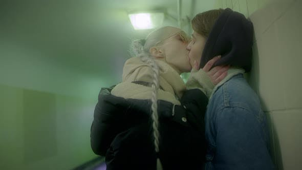 Two Girls Passionately Kissing in the Underpass