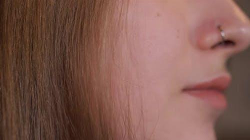 Woman Bites Her Lower Lip
