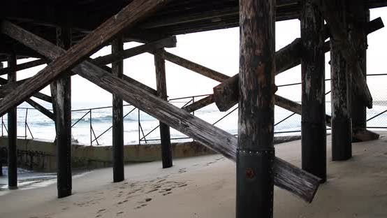 Thumbnail for Background plate of A wooden pier near the sand and water with a blown out sky