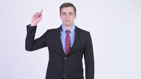 Thumbnail for Young Happy Handsome Businessman Pointing Up