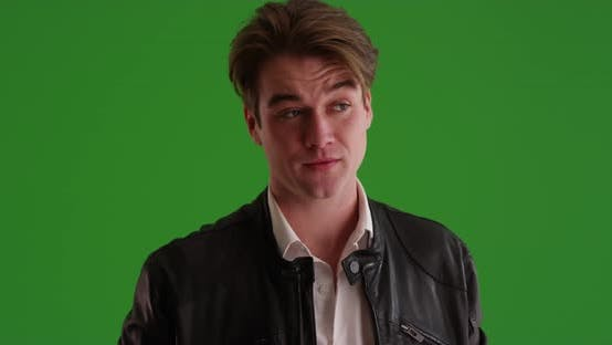 Thumbnail for Young Caucasian male waiting nervously for date to arrive on green screen