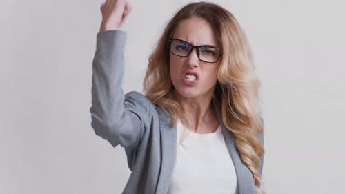 Angry Furious Woman Screaming and Shaking Fist at Camera