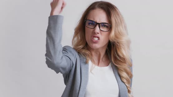 Thumbnail for Angry Furious Woman Screaming and Shaking Fist at Camera