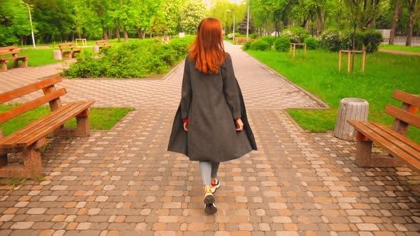 Thumbnail for Female Walks in City Park Enjoy Sunny Day