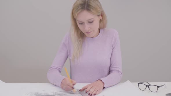 Thumbnail for Portrait of Concentrated Caucasian Woman Drawing Blueprint, Doing Mistake and Breaking Pencil