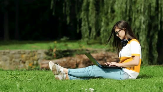 Thumbnail for Woman Working on Laptop in Park