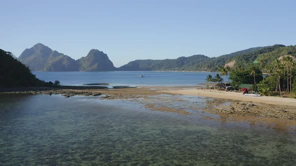 Thumbnail for Aerial View of Cas Cabanas, El Nido, Palawan, Philippines. Tourists Walking on Tropical Sandy Beach