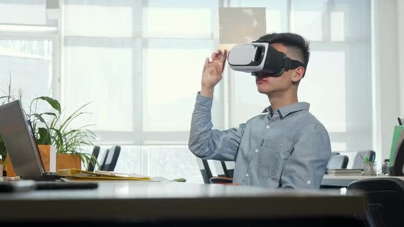 Thumbnail for Young Businessman Using 3d Vr Glasses at Work