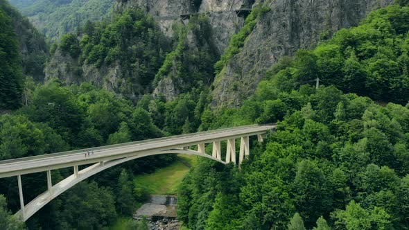 Thumbnail for Aerial View of the Arched Bridge Connecting a Mountain Road in the Romanian Carpathians