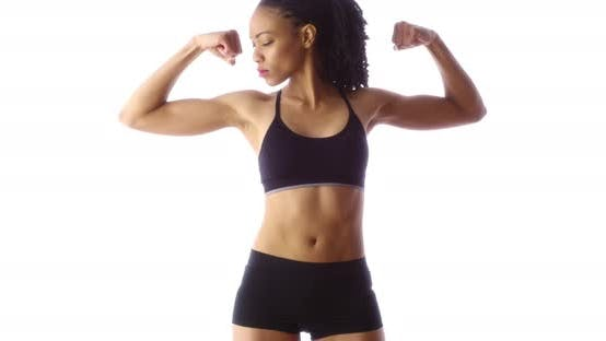 Thumbnail for Black woman showing off muscles