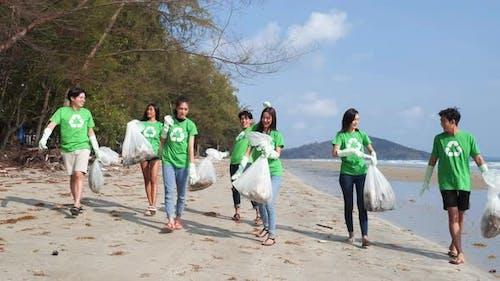 Volunteer cleaning beach