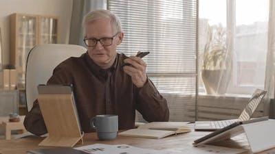 Successful Elderly Businessman Working in Office