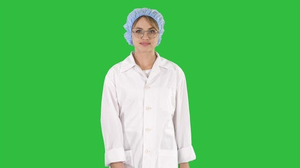 Thumbnail for Nice Blonde Woman Doctor Walking on a Green Screen, Chroma Key.