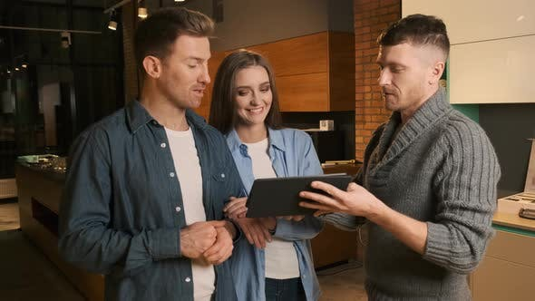 Thumbnail for Salesman Serving Customers in Kitchen Furniture Store Showroom. Couple Choosing Kitchen Furniture