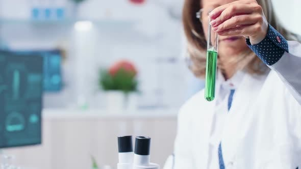 Thumbnail for Female Scientist Looking at Green Bio Sample