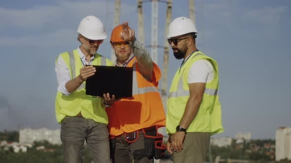 Thumbnail for Builders Using Laptop on Construction Site