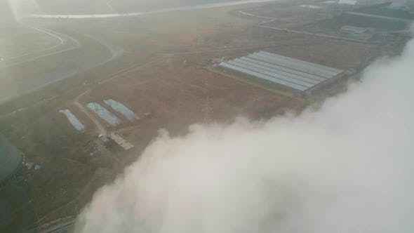 Aerial Orbital View of an Industrial Zone Pipes Pouring Thick White Smoke