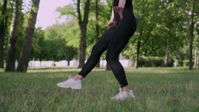 Woman Gymnast in a Jump