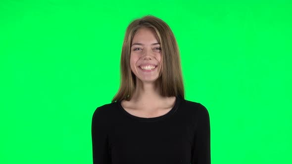 Thumbnail for Young Woman Smiling While Looking at Camera and Laughing. Green Screen