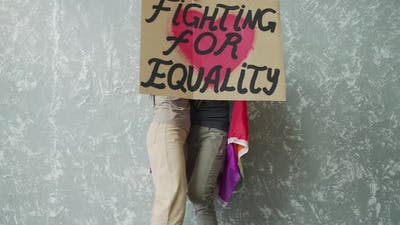 Young Women Raising High the LGBT Poster
