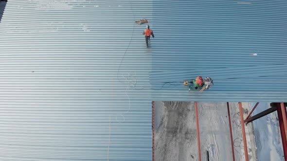 Thumbnail for Aerial Shot. Shooting From the Air. In the Frame of the Workers Are Builders, Mount the Roof of the