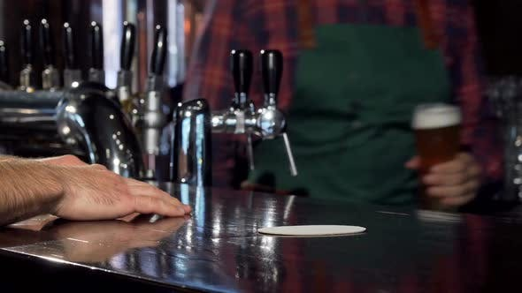 Thumbnail for Bartender Serving Delicious Beer To a Customer
