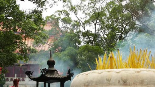 Religious Sticks Smoke in Front of Buddhist Temple
