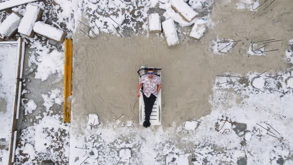 Aerial View on Top Builder Who Took a Break From Construction at Zik