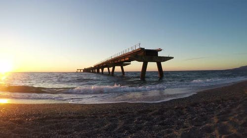 Destroyed Wharf at the Sunset, South Italy