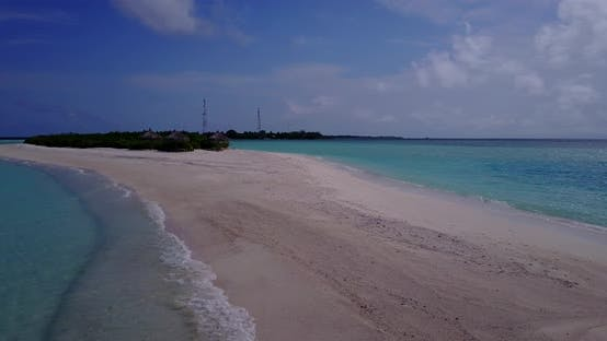 Thumbnail for Wide angle birds eye abstract shot of a white sandy paradise beach and aqua blue water background