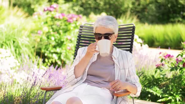 Thumbnail for Happy Senior Woman Drinking Coffee at Garden