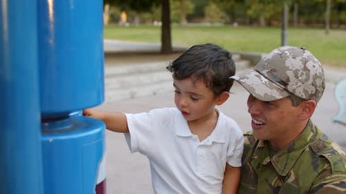 Military Daddy Spending Leisure Time with Little Son in Park