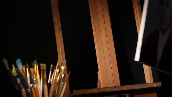 Thumbnail for Equipment for Painting, Rotation Wooden Easel and Painter Puts the Picture on It, Lot of Brushes