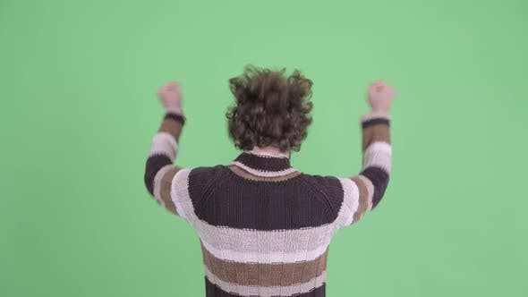 Thumbnail for Rear View of Happy Young Man with Fists Raised Ready for Winter