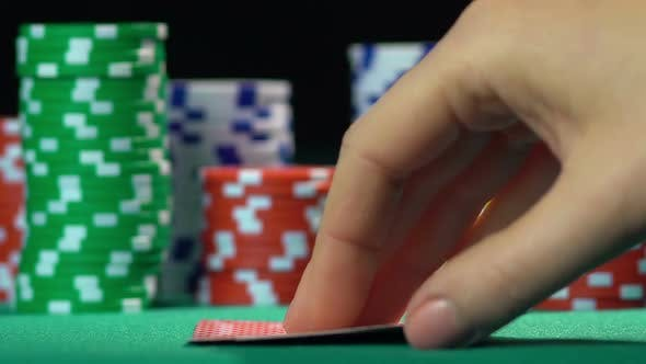 Thumbnail for Poker game, player holding winning hand, pair of aces. Successful person, winner