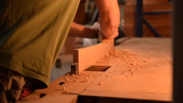 Thumbnail for Carpenter Planing Wood in His Workshop in Slow Motion