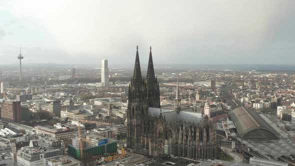 Thumbnail for AERIAL: Towards Beautiful Cologne Cathedral with Central Train Station in Beautiful Hazy Sunlight