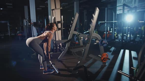Thumbnail for Athletic Woman Doing Workout Lunge With Barbell Flexing Muscles Training Hands and Back
