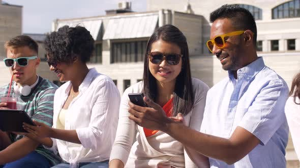Thumbnail for Students with Smartphones and Tablet Pc in City