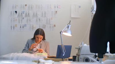 A Young Woman Designer Making a Dress in the Studio Dress