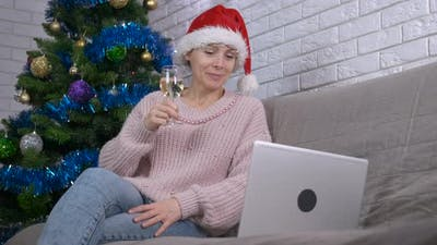 Clinking glass of champagne online.