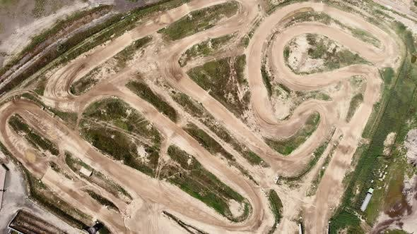 Empty professional motorcycle racetrack. Dirty enduro off road motocross track, aerial drone view