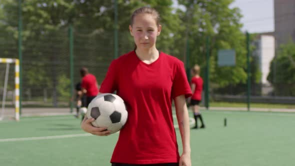 Thumbnail for Happy Soccer Girl Smiling and Posing for Camera on Outdoor Field