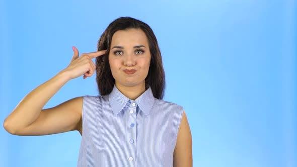 Thumbnail for Female Putting Fingers To Her Temple Like Gun Feeling Tired