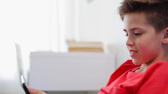 Thumbnail for Boy with Tablet Computer Having Video Chat at Home