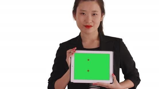 Thumbnail for Smiling business lady holding handheld tablet with green chromakey for copyspace