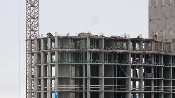 Thumbnail for Crane on Construction Site Residential Estate Building in City Constructors Working Cloudy Day