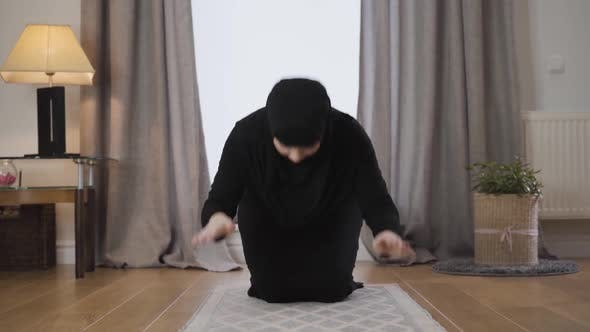 Thumbnail for Portrait of Young Muslim Woman in Black Traditional Dress and Hijab Praying at Home. Beautiful Lady