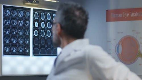 Doctor Analyzing Eye on X Ray
